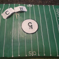 Go Wildcats! Half sheet cake football field vanilla cake with vanilla buttercream. Gumpaste flags and center logo.
