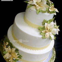 Gold And Ivory Christmas Wedding Buttercream finish, with Ivory Poinsettias, with Gold Centers....Thanks for looking!Hope you enjoy!.....................Edna :)