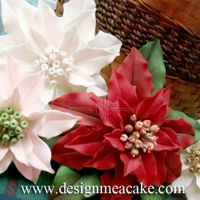Gumpaste Poinsettias All sorts of fun color Poinsettias..thanks for looking!....................Edna :)