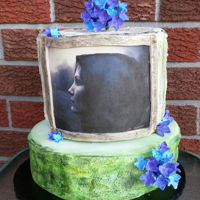 Happy Birthday Samantha  Picture is of my daughter taken by her talented husband. Tree bark effect on bottom tier. Cake is chocolate chip. Hydrangeas are clay craft...