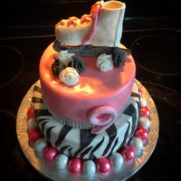 Ice Skate Birthday Cake Mmf covered almond cake with and almond pastry cream filling. Gumpaste skate and gumball border