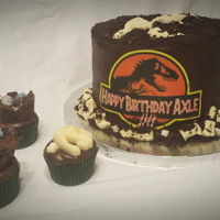 "Jurassic Fossil Dig Cake Chocolate cake with chocolate buttercream. The layers are filled with oreo cookie crumbs and cnady melt ""bones"" I molded using an..."