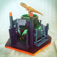 Jurassic World Cake Fondant cake with buttercream piping. 8 and 6 inch. Store bought fence and dinosaur