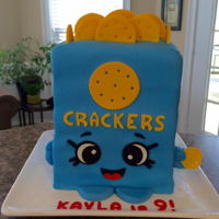 Kris P Crackers Shopkins is the theme of this birthday cake