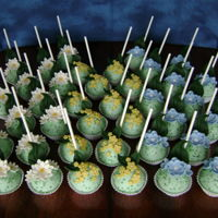 Moms Day Floral Cake Pops vanilla-butter cake, vanilla ABC binder, white almond bark, MMF and sprinkle adornments, angled sticks
