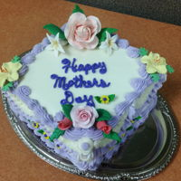Mother's Day 2016 This was for my co-workers for Mother's Day. Carrot cake with cream cheese buttercream that was so delicious. The flowers and leaves...