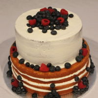 Naked Cake Chocolate & Butter cakes filled with buttercream and decorated with blueberries & raspberries.