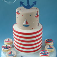 "Nautical Themed Christening Cake 8"" Extended height base tier with horizontal stripes (took forever!) with 6"" top tier with painted boats. All vanilla."