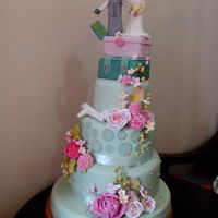Pastel Green And Pink Wedding Cake Decorated with handsculpted gumpaste roses, carnations, fillers, and berries.
