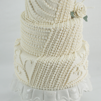 Pearl Beaded Wedding Cake This wedding cake boasts incredible pearl detailing.