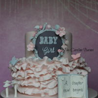 Pink And Grey Enchanted Forest Baby Shower Cake Enchanted forest baby shower cake in pink and grey. With a floral garland, chalkboard effect, ruffles, butterflies and mushroom stalks. The...