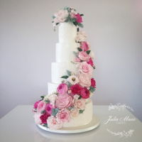 Pink Floral Cascade Wedding Cake I made this cake for my brother and sister in laws wedding recently.It stood over 30 inches tall and was decorated in over 150 sugar...