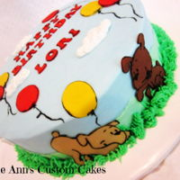 Puppies And Balloons I got the inspiration for this cake from a card I saw, I had fun with it and the puppies are so cute! BC frosting with fondant accents,...