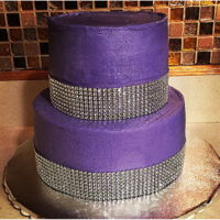 Purple Piñata Cake WASC cake. Top tier was filled with candy.