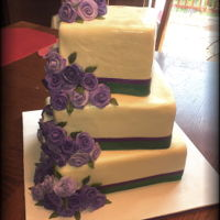 Purple Roses White mmf over a marble of vanilla and chocolate cake with vanilla buttercream. Purple fondant roses, disted with pearl lustre.