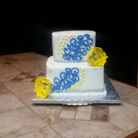 Royal Blue And Yellow Wedding Cake   Two Tier Cake w/ Gumpaste flowers. Bling and rhinestone buttons.