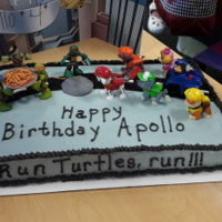 Run Turtles Run! Half Sheet Cake, vanilla cake with vanilla buttercream. Fondant pizza, manhole cover and road. Customer provided the toys for the rest of...
