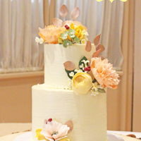 Rustic Flower Wedding Cake Two tiers with a textured buttercream covered in a variety of sugar flowers.
