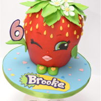"Shopkins ""strawberry Kiss"" Strawberry Kiss character from Shopkins. Carved vanilla cake covered in ganache and fondant."