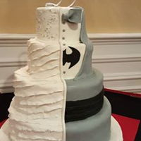 Split Wedding Cake My 2nd cousin's wedding cake...the groom love's batman and the bride's side represented her dress. Ruffles and sugar...