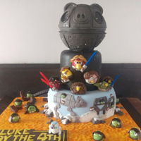 Star Wars Angrybirds 2 layers of chocolate sponge cake, covered in fondant. Pig topper made of rice krispy treats. Sugarpaste characters.