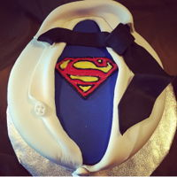 Superman Cake Dark chocolate velvet cake, covered in ganache, then covered with fondant. Logo was handmade made from candy melts. I made this for my DH...