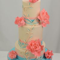 Teal And Coral Wedding Cake Finished in buttercream