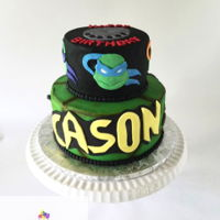 Teenage Mutant Ninja Turtle Cake Buttercream iced 2 tier cake with fondant turtle designs.