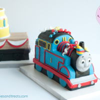 "Thomas With Birthday Cake Trailer  Taking the birthday boy's favorite toy and turning it into cake was a lot of fun to do! I heard he loved it! Each trailer is 9"" L..."