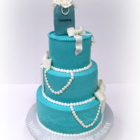 Tiffany Inspired Birthday Cake Birthday cake for an 18 year old who loves Tiffany jewelry. Cake decorated in buttercream with fondant Tiffany bag topper, bows and pearls...