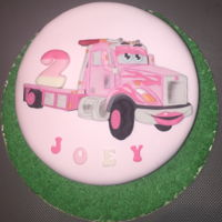 Truck Themed Cake For A 2 Year Old Girl Vanilla cake covered in fondant with a 2d cutout