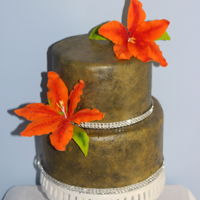 Two Tier Textured Fondant Cake. A little attempt in adding texture to black fondant using a sponge. The Stargazer Lilies are made from sugarpaste.