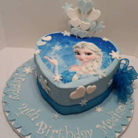 We Love Elsa Frozen inspired heart shaped Elsa Cake with heart and snowflake spray.
