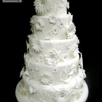 White Garden  This Cake was featured in the first issue of the CC magazine. Fondantfinish with gumpaste flowers. Thanks for looking...