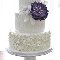 White Wedding Cake With Purple Flower Hand piped lace with ruffles