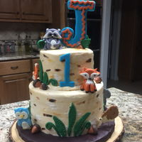 Woodland Animals Sour cream cake iced in bc with fondant accents.