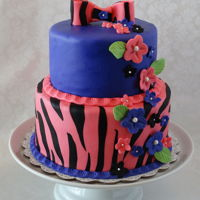 Zebra Print With Flowers   Six and eight inch rounds in fondant with fondant flowers.