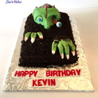 Zombie Birthday Cake Cake covered in buttercream and crushed oreos with modeling chocolate zombie. Thanks for looking!