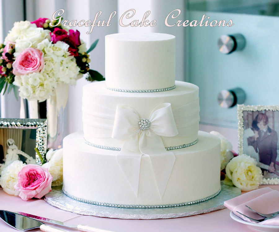 Elegant White Butter Cream Wedding Cake With Fondant Sash And Bow on Cake Central