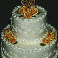 50Th Anniversary White textured buttercream with shell borders, piped side scrolls and gold gumpaste roses.