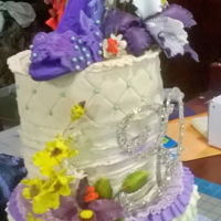 A Sexy Stiletto For A Fabulous Fashionista Buttery pound cake draped in sweet buttercream ruffles and topped with a sugar lace stiletto and surrounded in an orchid bouquet