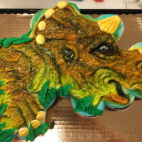 Baby Triceratops Cupcake Cake 24 cupcakes decorated with buttercream and airbrush
