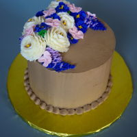 Buttercream Flower Cake Chocolate cake filled with caramel swiss meringue buttercream and frosted in chocolate swiss meringue buttercream. The flowers are supposed...
