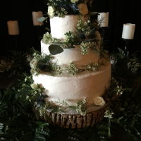 Buttercream Wedding cake made with tiers of chocolate fudge with salted caramel filling, Almond cake with Dark chocolate ganache', and Italian Cream cake...