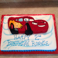 Cars Birthday Cake Molded cars cake on top of a half sheet cake.