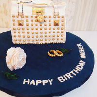 Craze For Bags! A moist pinnaple cake with swiss meringue butter cream encased in a MK bag. Decorated with fondant and royal icing bead work along with...
