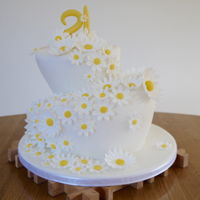 Daisy Cake   Wonky cake - 9 inch and 6 inch tiers carved to wonky shape, with cascading gumpaste daisies.