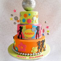 Disco Dance Birthday Cake Disco dance themed cake for a girl who loves dancing. Disco ball topper is styro covered in fondant and then individual fondant tiles glued...