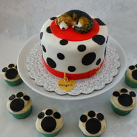 Dog Cake And Cupcakes   Six inch round cake in fondant with gumpaste dog. Lemon cupcakes with cream cheese icing and fondant paw prints.