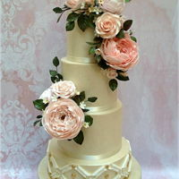 English Rose Wedding Cake Inspired by the beauty of rose gardens in full bloom, this wedding cake was decorated with sugar English roses, ranunculus, classic roses,...
